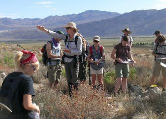 Anne Egger teaching students on a geoscience fieldtrip
