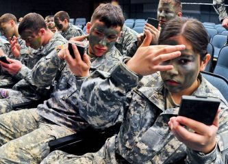 North Dakota National Guard recruits practice applying camouflage face paint as part of their training. Chemists from the University of Southern Mississippi are formulating a new silicon-based paint that can reflect the intense heat of a bomb blast or fire. Image: Senior Master Sgt. David Lipp, courtesy of The U.S. National Guard (CC).
