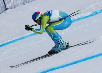 A downhill skier races in the 2010 Olympic games. (Credit: Jon Wick)