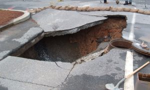 9.75-meter (32-foot) deep sinkhole in Georgia Tech parking lot, Atlanta, GA, formed as rainwater leaked through pavement and into break in sewer line below. (Credit: Scott Ehardt, Wikimedia Commons)