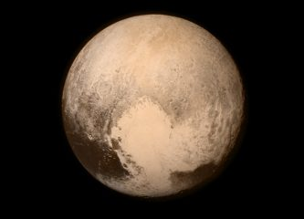 NASA's New Horizons spacecraft sent this image of Pluto taken on July 13, 2015, when the spacecraft was still almost half a million miles (768,000 kilometers) from the surface. The view is dominated by a large, bright heart-shaped feature, now unofficially named the Tombaugh Regio in honor of the American astronomer who discovered Pluto in 1930. The feature measures approximately 1,000 miles (1,600 km) across. Credits: NASA/APL/SwRI