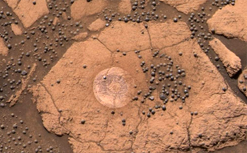 "The small spheres in this picture were dubbed ""berries"" by geologists who first saw them."